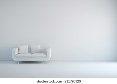 White room with sofa and empty background wall