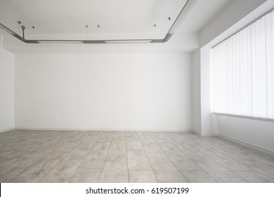 White room with window, empty space