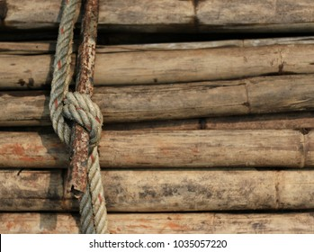 White rope bind rusty steel rod wite stack bamboo background in day light