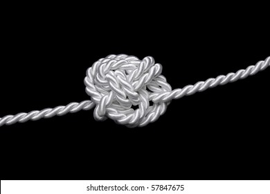white rope bound to a difficult knot, black background