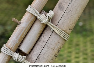 White rope tied together bamboo to construct.