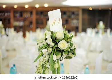 white rose bouquet with table number card