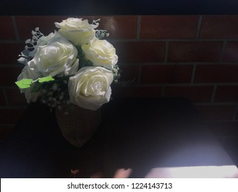 White rose bouquet in vase on dark light.bouquet flower for decor.
