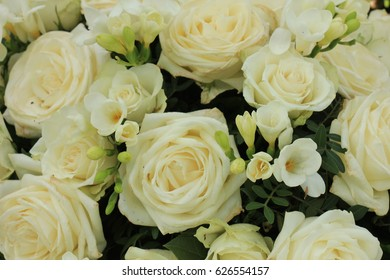white rose and freesia bouquet for a wedding