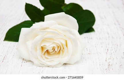 white rose  on the old wooden table