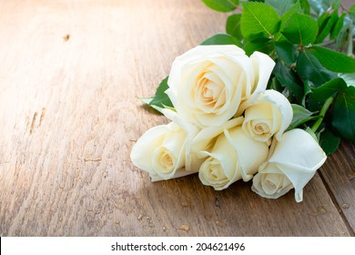 white rose on the plank