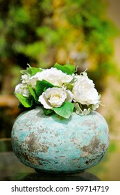 White rose in a vintage pot
