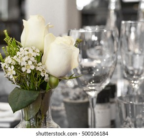 White roses adorn table/ White Roses/White Roses Adorn Table For Festive Occasion