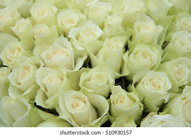 White roses in a floral wedding arrangement