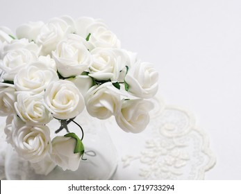 White roses in glass on white background with soft focus