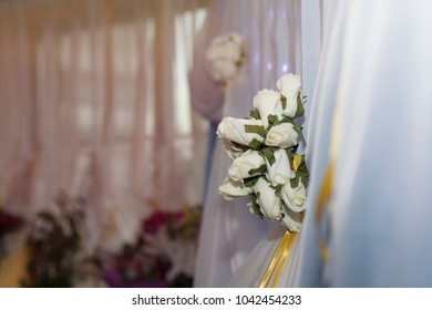 White roses on the curtain. Wedding interior. Soft color.