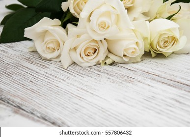 White roses on a old white wooden table