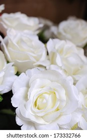 White roses showing in market fair, artificially