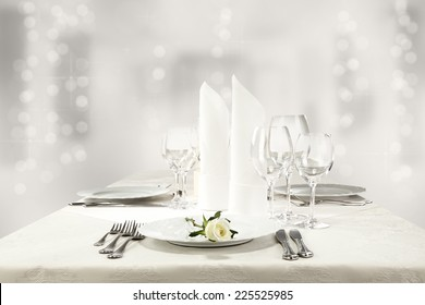 white roses and silver table of food
