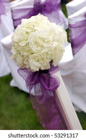 White roses wedding bouquet with violet ribbon