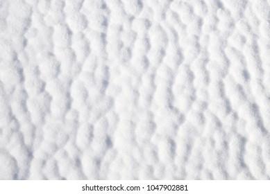 White rough frozen snow texture background