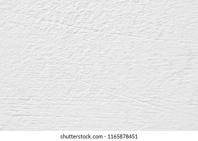 White rough whitewashed wall texture close-up.