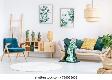 White round carpet in rustic living room with gold pillow on beige couch and pineapples on wooden cupboard