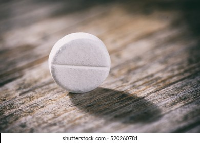 white round pill paracetamol or aspirin. Painkiller remedy