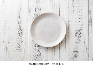White Round Plate on white wooden table background