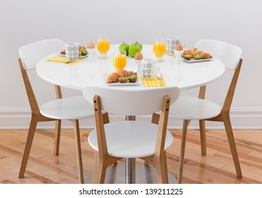 White round table with healthy breakfast for three.