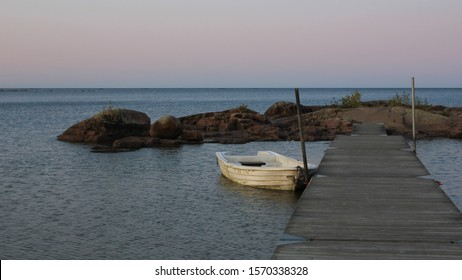 White rowing boat at the shore of Lake Vanern, Sweden.