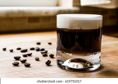 White Russian Cocktail with coffee beans.