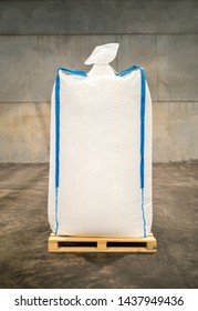 White sack bag at large warehouse in modern factory. Packaging in factory or warehouse