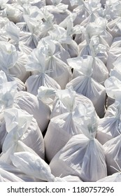 White sacks filled with sand
