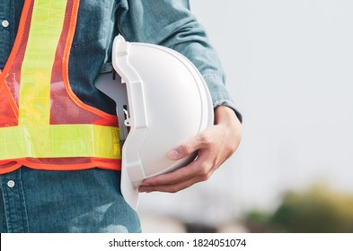 White safety helmet is in the hands of an engineer.