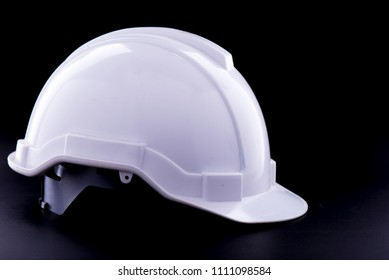 White Safety helmet on black background