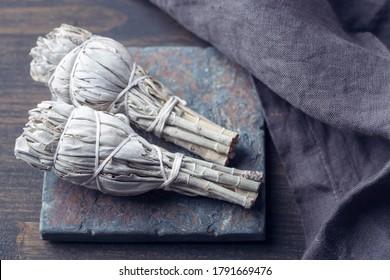 White sage smudge stick on grey background