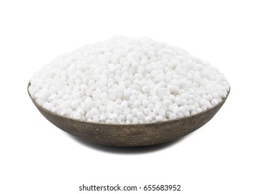 White Sago Pearls in Vintage Bowl Also Know as Sabudana, Tapioca Pearl or Sago Seeds isolated on White Background