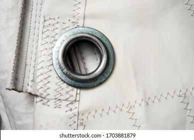 A white sail with eyelet