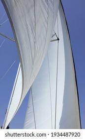White sail on blue summer sky