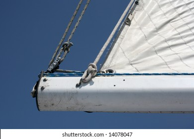 White sailboat boom with clear blue sky background