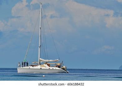 white sailboat in calm sea