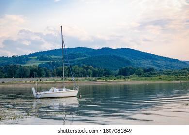 White sailboat on the Lake Mucharz. Jezioro Mucharskie, Poland - Shutterstock ID 1807081849