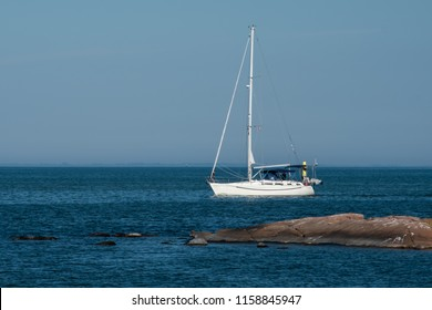 White sailboat running with engine