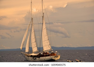 A white sailing boat in the middle of Raja Ampat, Indonesia. Yachting, Sailing, Ship, Sail.