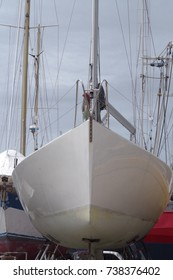 White sailing boat waiting in a storage position.