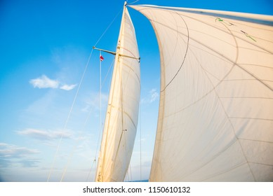White sails of the yacht against blue sky. Baltic sea, Latvia