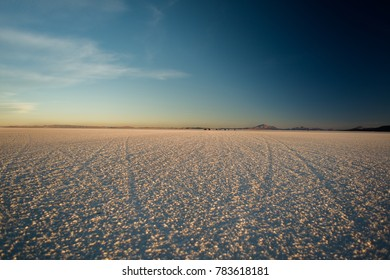 White salt flats sunset scenery of during dessert crossing with a 4x4  in Uyuni Salt Flats in Bolivia.