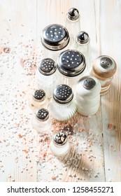 White salt in salt shaker with different types of salt