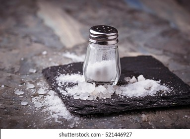White salt in shaker. Selective focus
