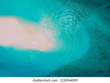 White sand bank and turquoise ocean from above