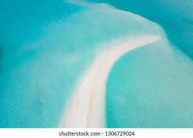 White sand bank and turquoise ocean from above. Amazing tropical aerial landscape, beautiful nature