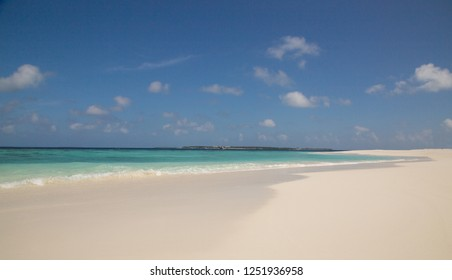 White sand beach atoll island Maldives.