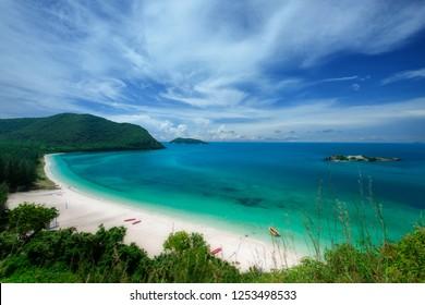 White sand beach with blue sea on Koh Samaesarn. Sattahip, Chonburi, Thailand