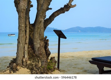 White sand beach blue sea and blue sky , Nice view and beautiful mountain from island in tropical country
